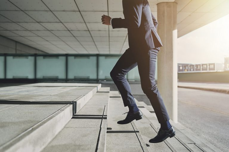 Man climbing the stairs of success