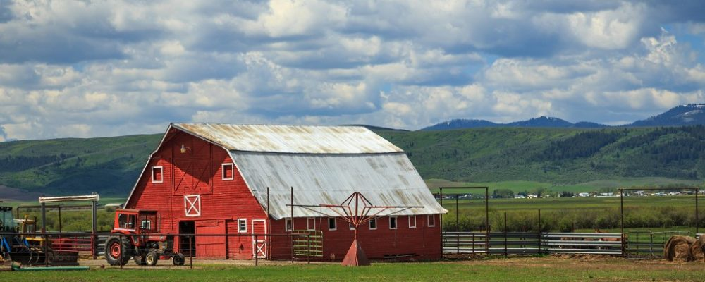 Red barn near the mountains