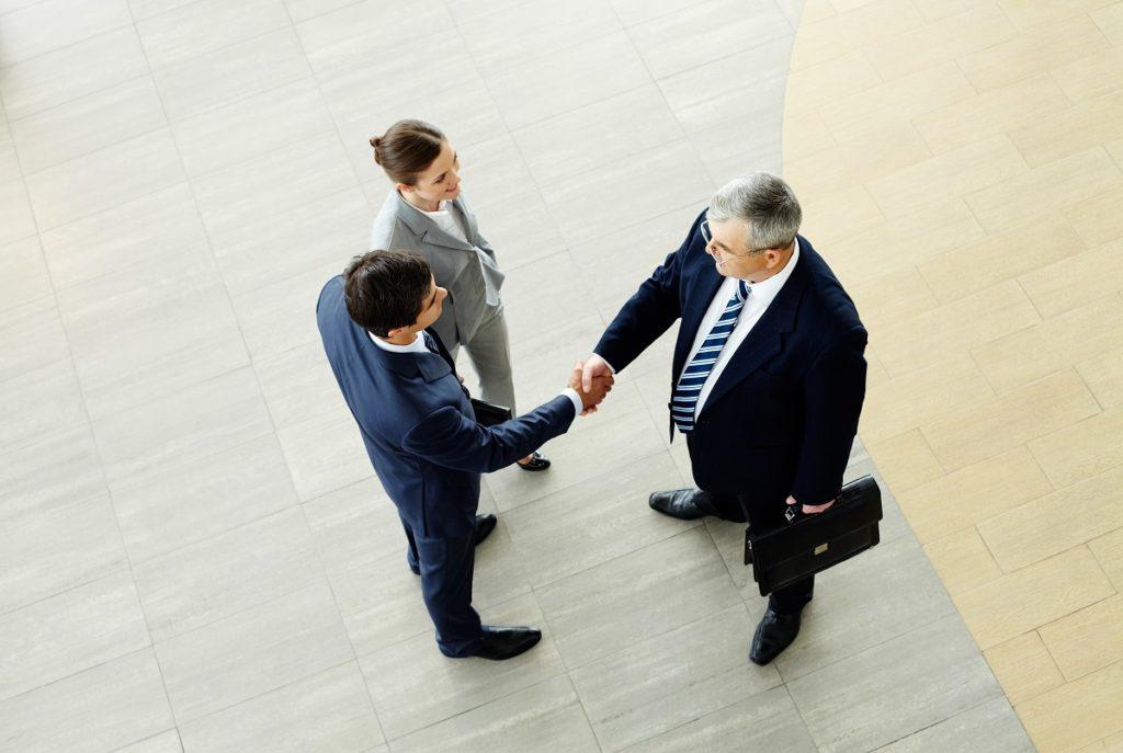 Old businessman shaking hands