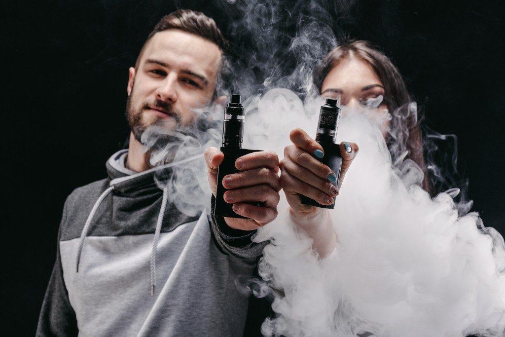 Couple in a cloud of vape
