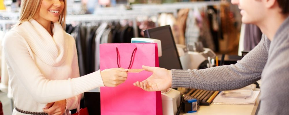 woman purchasing from a physical store
