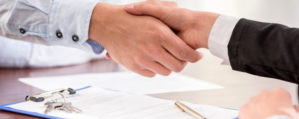 Agent shaking hands with the client