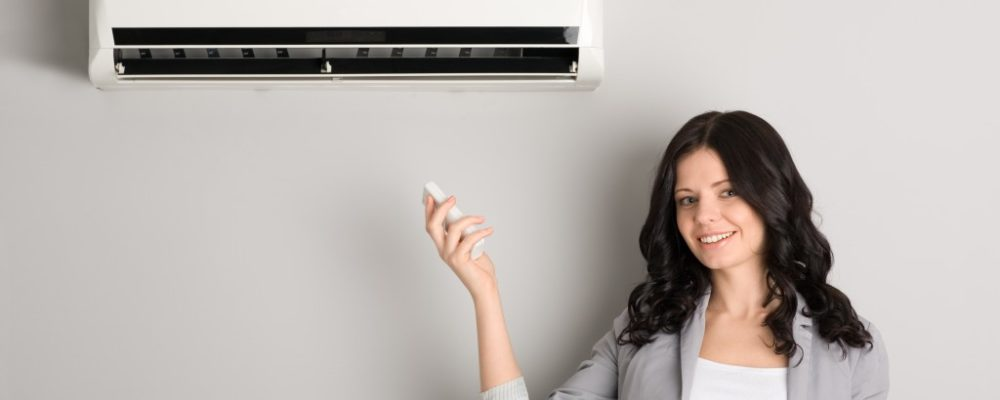 woman satisfied with her air conditioner