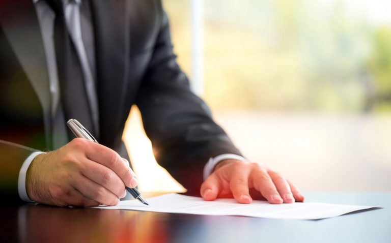 Man signing with a pen
