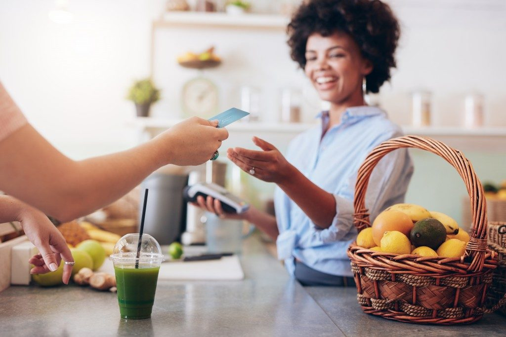 Woman accepting payment from customer