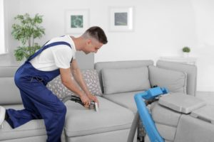 Man cleaning the house using a vacuum