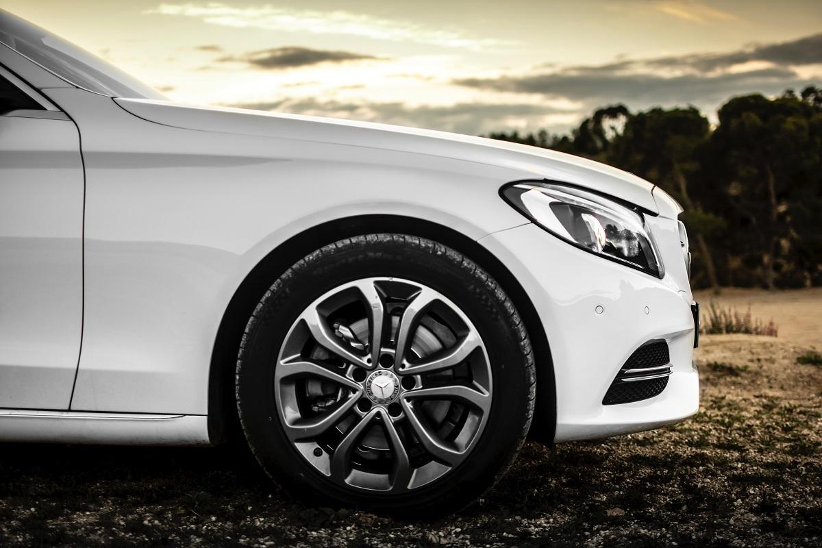 Close up of white car's bumper