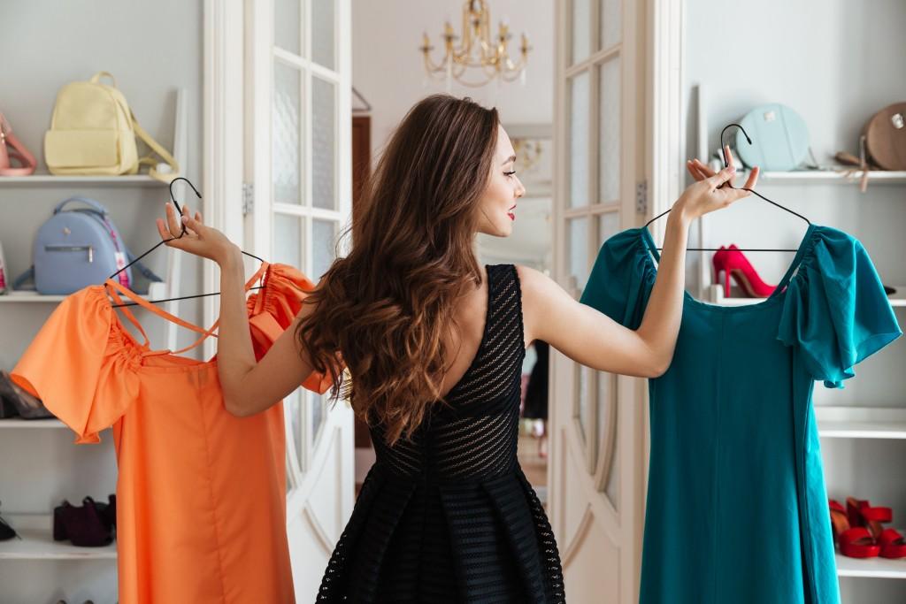woman choosing a dress