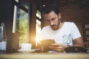 Man looking at his tablet