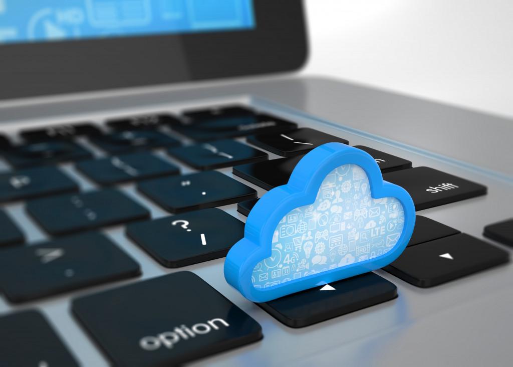 cloud miniature on top of a laptop keyboard