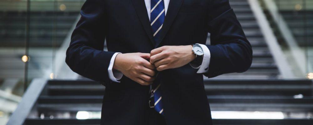 businessman adjusting his suit