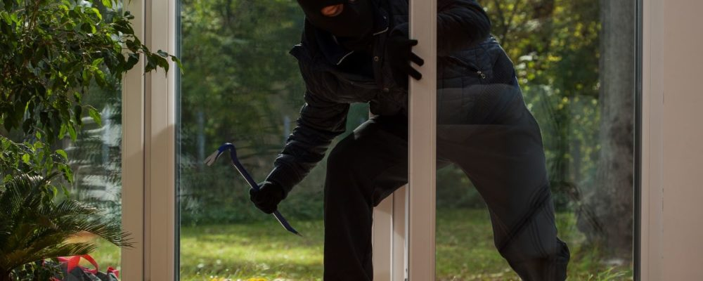 robber breaking into house