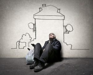 man sitting in front of a mural