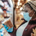 woman shopping wearing facemask