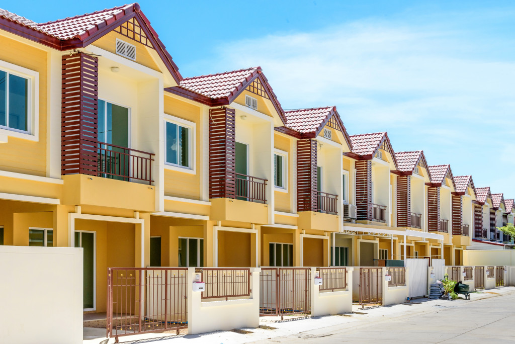 A row of just finished new yellow townhouses
